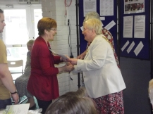 presenting certificates to the Welcome Group