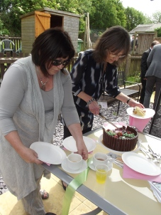 Karen and Jane cutting the amazing cake!