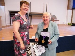 Eileen presents the outgoing Mayor with a memento of her year as Volunteering Champion