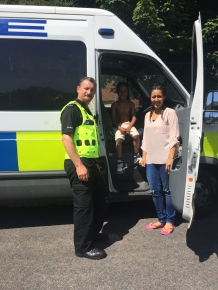 PC Paul gives a young visitor a tour of the riot van!